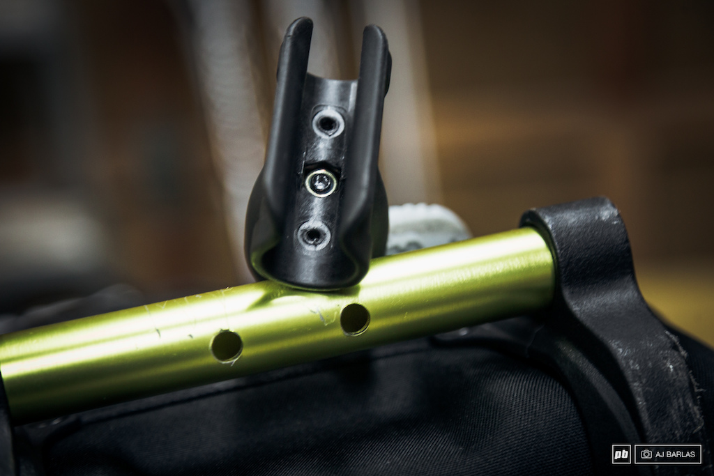 The third wheel attachment. Note the missing pins that were inside the clip which line up with the holes in the alloy handle.