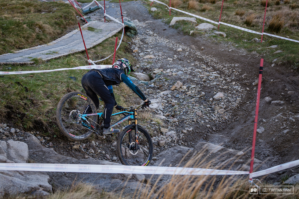 """Danny almost gets hung up in a 29"""" sized hole - note the wear on the seat of his race pants from scuffing the big wheels."""