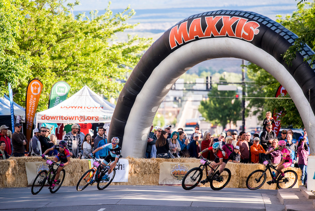 The pro s round a corner at the start of the Pro Women Fat Tire Crit on Friday.