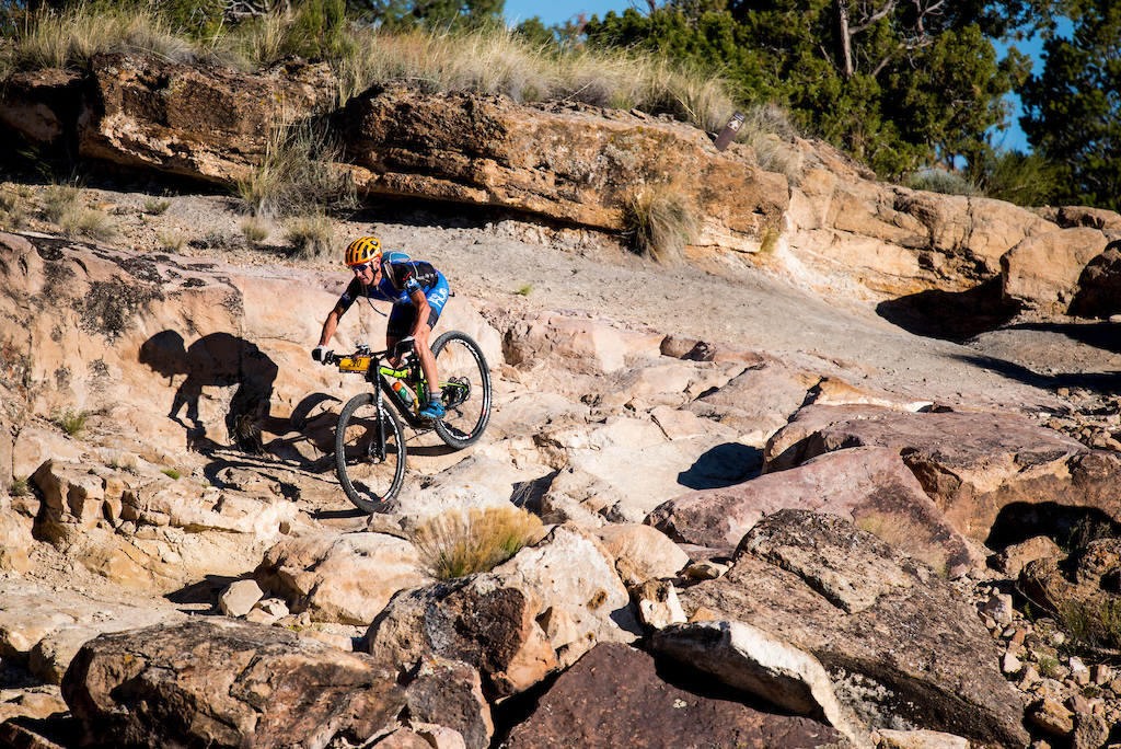 A racers descends a technical section of the Tabeguache Trail.