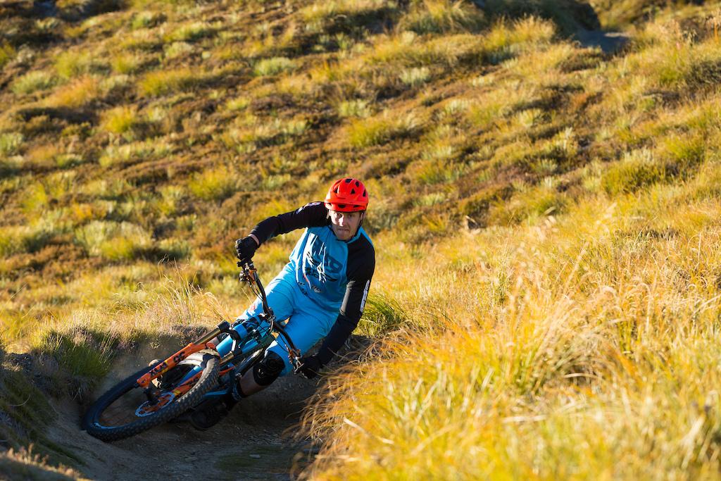 Cornering XC trail Coronet Peak. Queenstown,