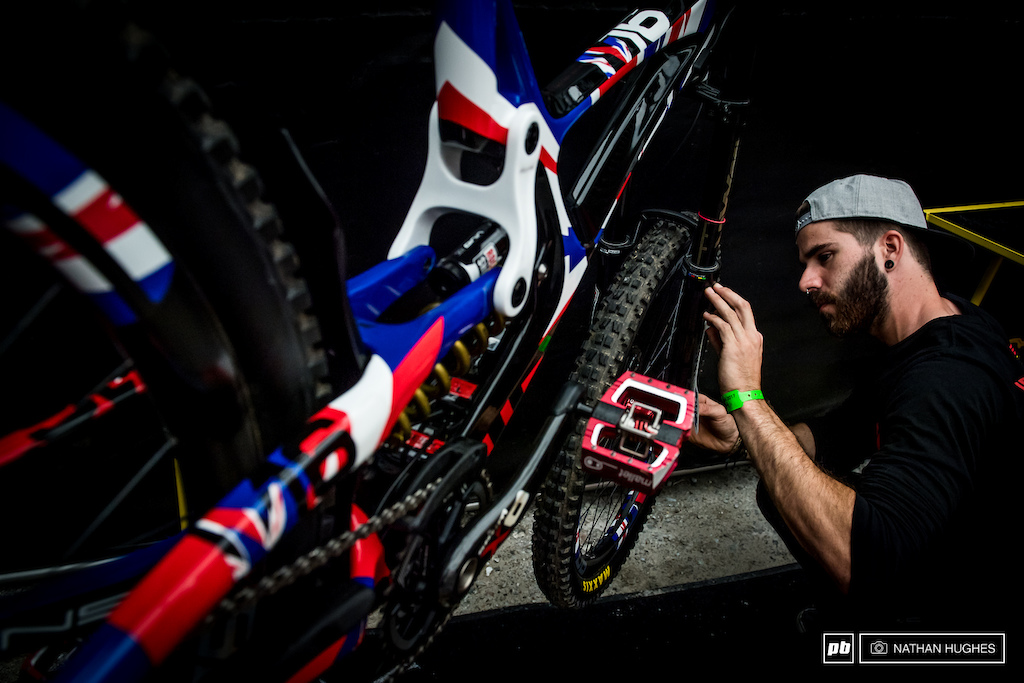 Ernie coordinating the Boxxer stickers on Nik Nesteroff s Union Jack M16 ride ready for GB s most legendary of races.