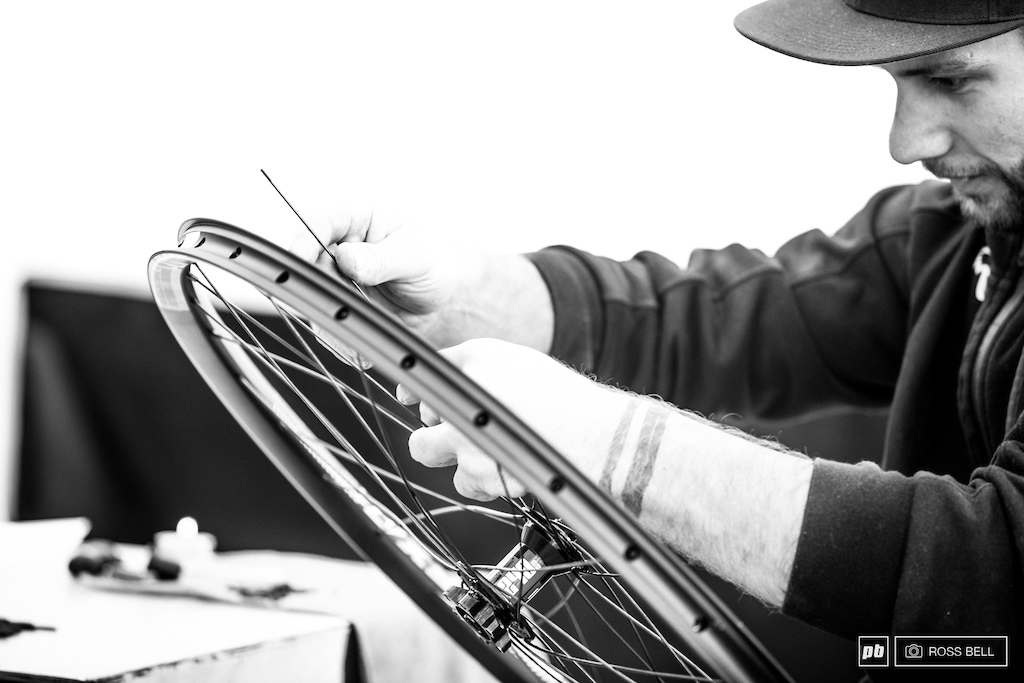 Specialized mechanic Kev Joly gets stuck into a wheel build this morning.