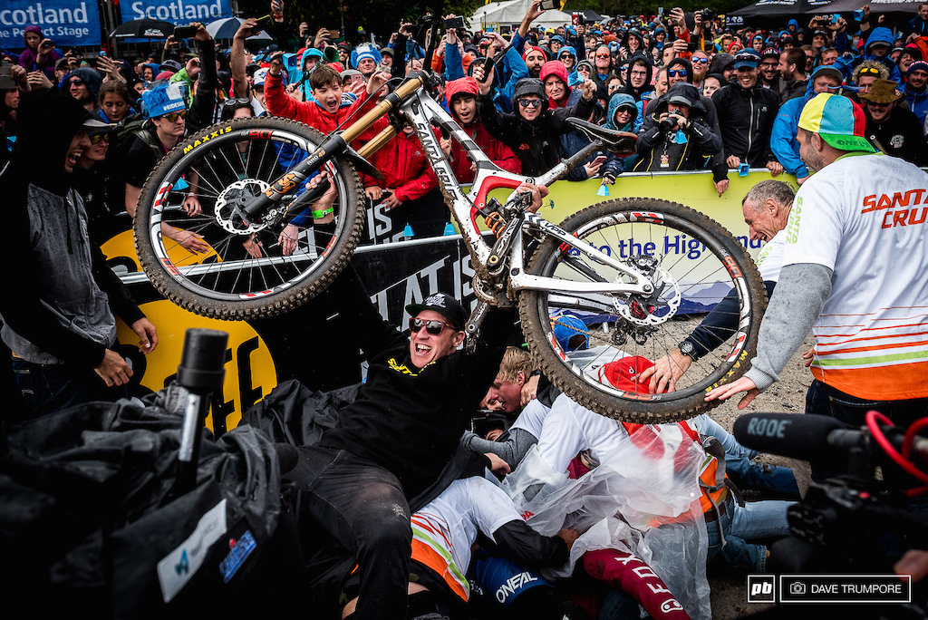 Minnaar on the bottom of the fishline pig pile and People s Champ Steve Peat on top with the day s fastest bike.