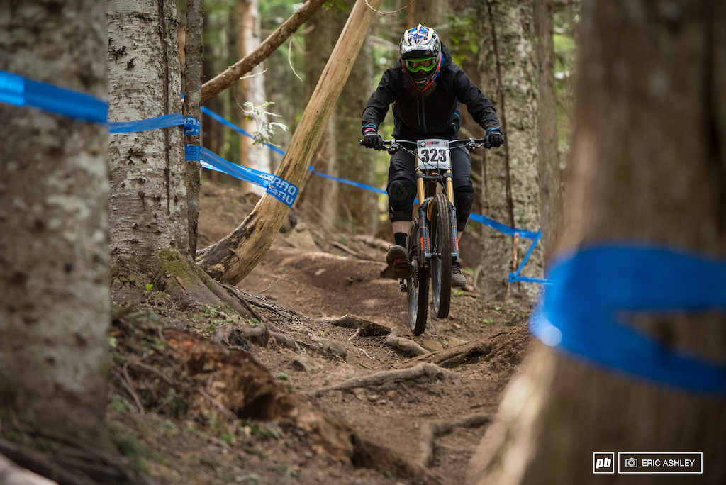 William Floyd airs out of a g-out through the roots near the bottom of the course Cat 1 Men 19-29 .