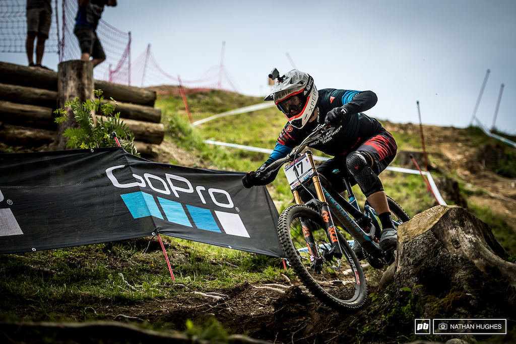 Austria's great hope, Markus Pekoll, hammering the loam between the stumps before the hall of fame section.