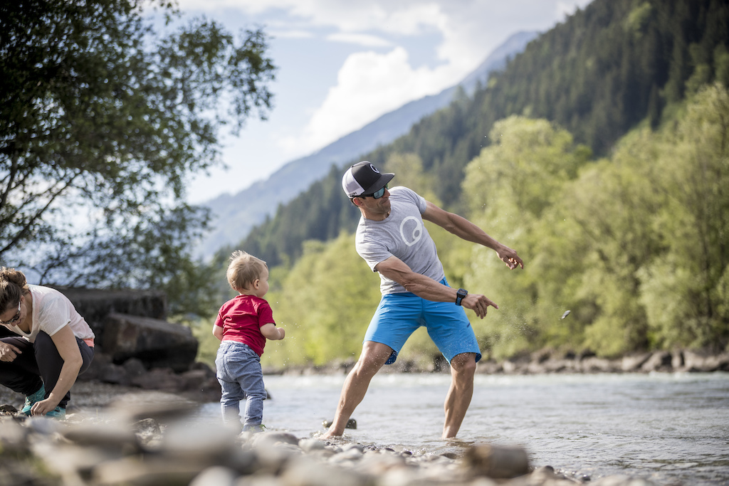 Quality time with the family. After a tough day of training it s the biggest pleasure for me spending time with my family. Riding a local track at the river Isel in Lienz is one of the highlights for all of us. At the beach we throw stones into the Isel and build sandcastles with Fabian.