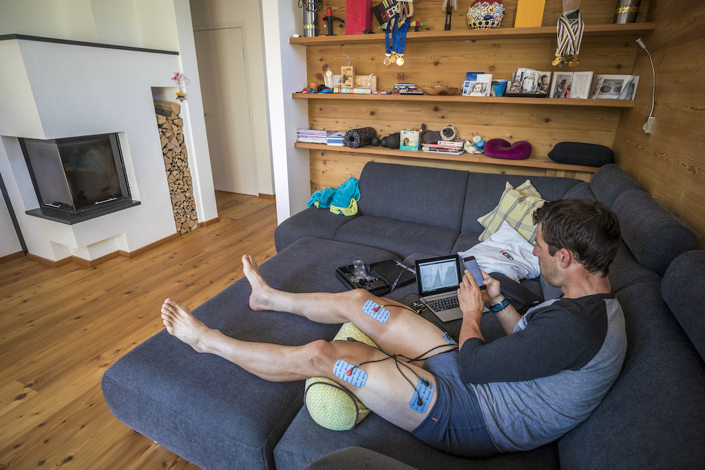 I always try to be multitasking. Electro stimulation for recovery on the couch and in the meantime doing some office work or watching cycling on TV.