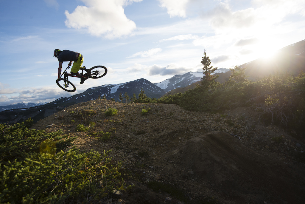 Norbz boosts an old mound left behind by mine explorations. John Wellburn photo