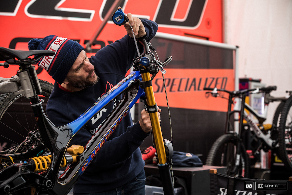 Loic Bruni s mechanic Jack Roure making everything s mm perfect after giving Loic s demo the Ohlins gold touch.