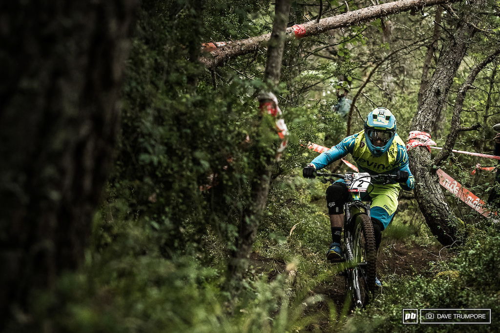 Damian Oton throws some shaped to avoid the tight trees on stage 1.