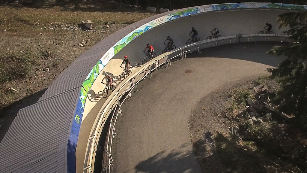 Even the climbs are interesting at the weekly Toonie rides in Whistler. Here riders ascend the bobsled track from the 2010 Vancouver Olympics on their way to Golden Boner.