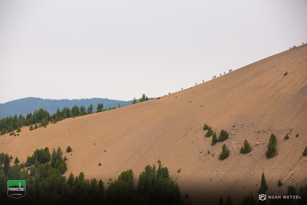 Riders hike to the scenic Stage 1 start on Day 2 at Panorama B.C. for the Trans B.C. Enduro.