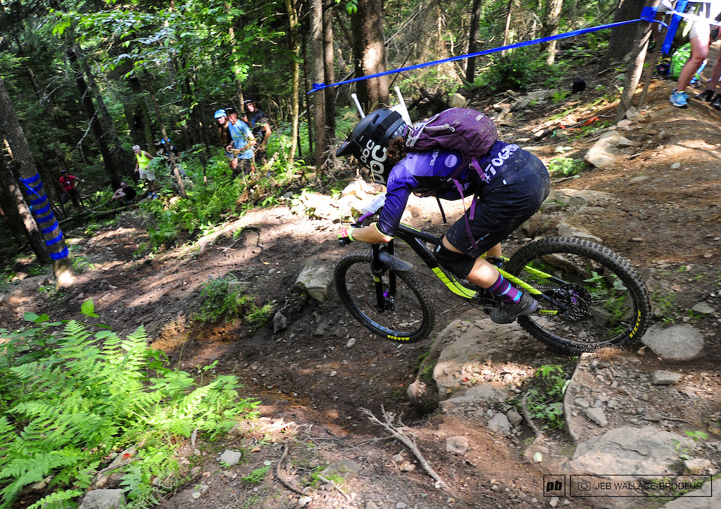 Emily Cox of Atlanta drops into a steep chute on Stage Two.