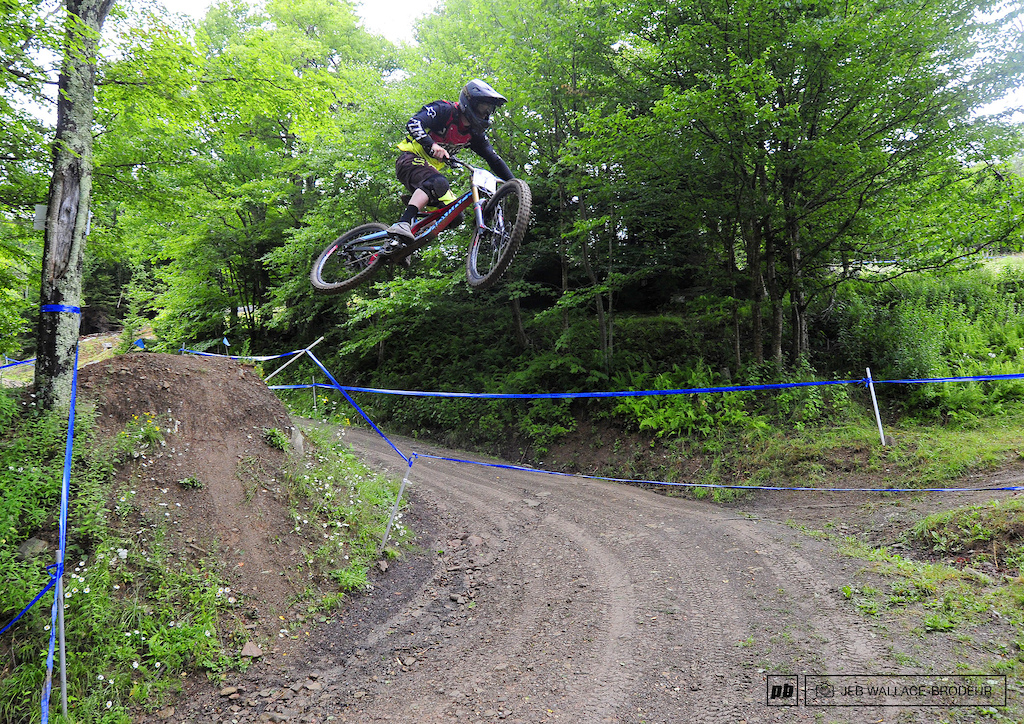Adam Delonais launched the track s second road gap one of the signature park features on the upper portion of the course.