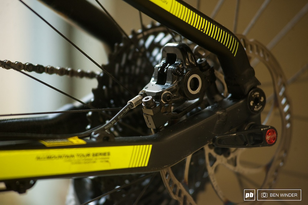 Located the brakes inside the rear triangle isn t a new idea but a great one to keep the caliper out of harms way.