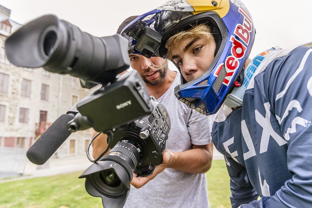 Filmer Jan Shuster and Finn Isles review footage during the making of Red Bull Purest Line in Quebec City Canada on July 21 2017.