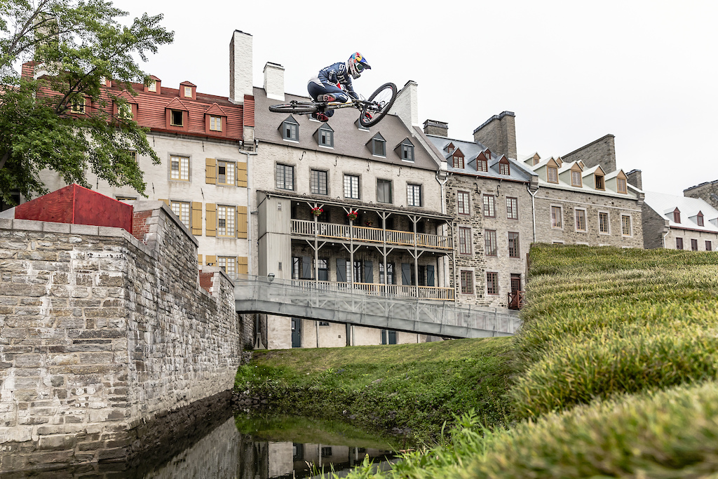 Finn Isles catches air on his downhill mountain bike during the making of Red Bull Purest Line in Quebec City Canada on July 21 2017.