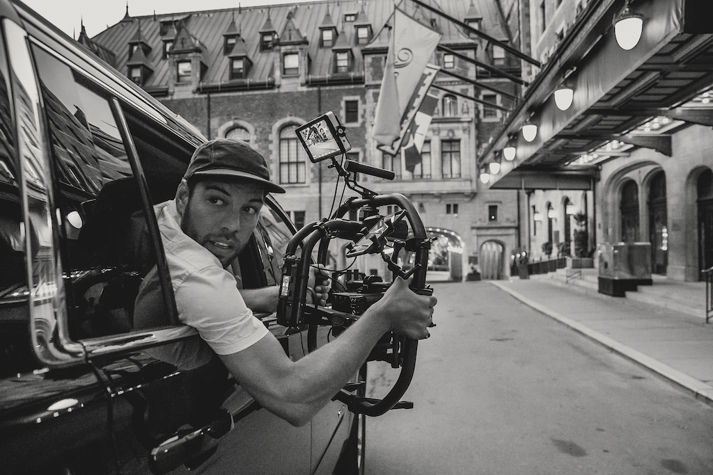 Filmer Jan Schuster prepares to film Finn Isles during the making of Red Bull Purest Line in Quebec City Canada on July 22 2017.