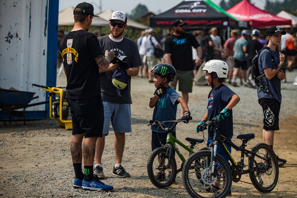 Sam Hill makes some kids or maybe their father stoked with a couple of autographs.