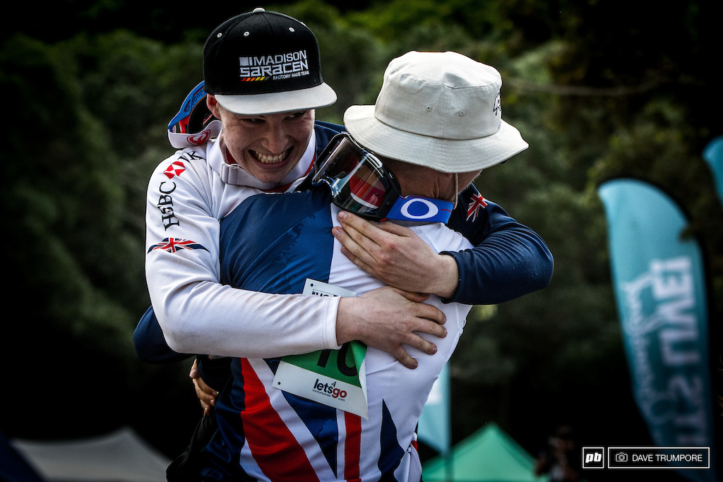 Kaos Seagrave hoists up a very happy Matt Walker as he clinched the junior world title.