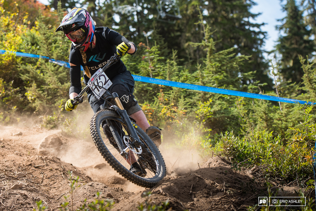 Sarah Olsen rips into a dusty berm in the clearcut section of Berserker Cat 1 Women 0-29 .