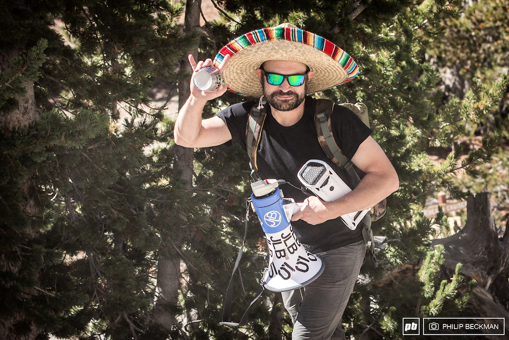 The super spectator. Cool beverage. Check. Bullhorn. Check. Sombrero. Check. Boombox loaded with Mexican death metal. Check.