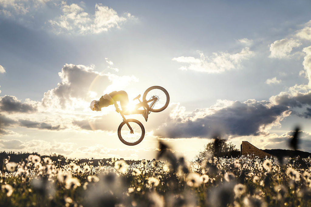 Dandelion dirt jump spot with a stunning sun set in the backyard of the local golf course.