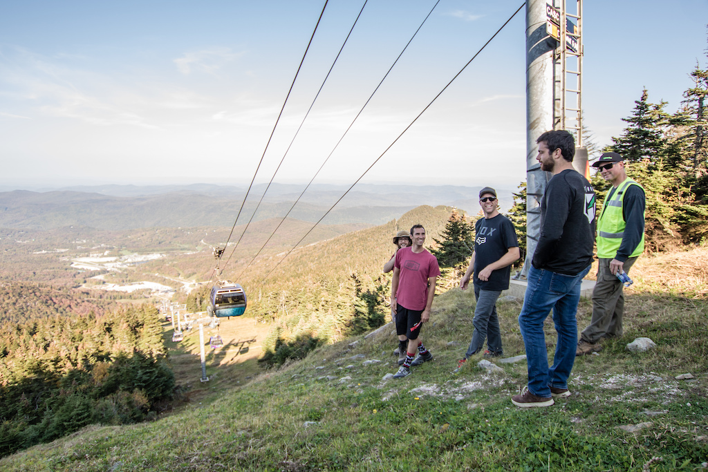 Neko Mulally discussing the future US Open DH track from the summit of the K1 Peak with long time Killington trail builder Rosey Clay Harper Jordan Newth and Zach Faulkner.
