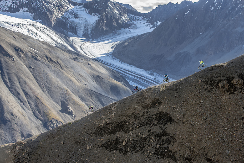 Tyler McCaul Carson Storch Wade Simmons and Darren Berrecloth ride down a previously untouched slope in the Tatshenshini-Alsek Provincial Park in British Columbia Canada on September 3 2016.