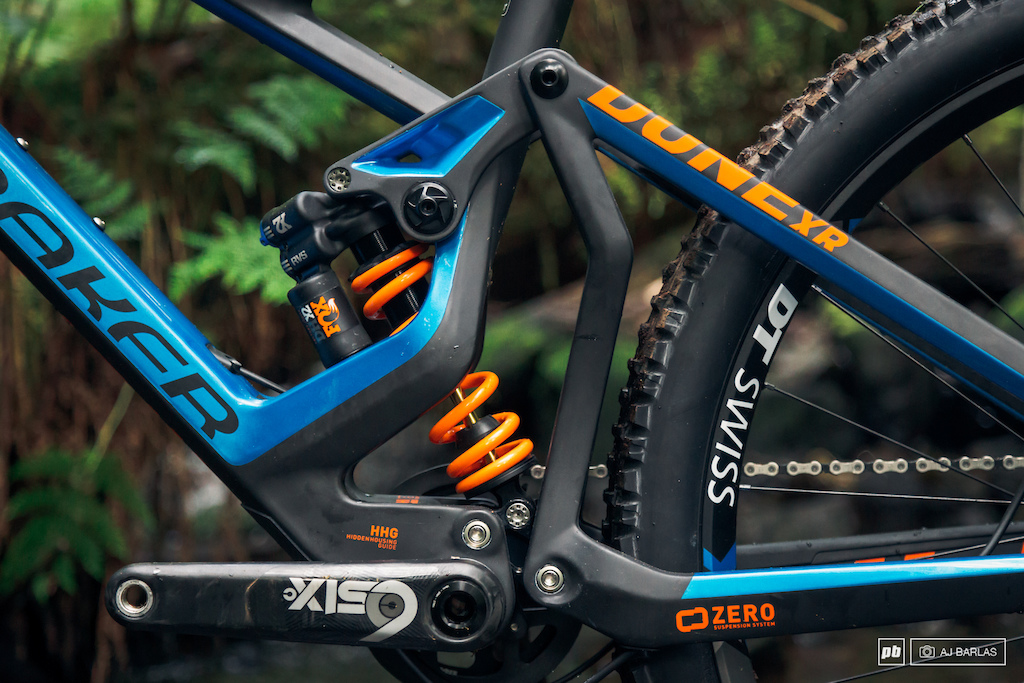 Mondraker s Zero Suspension System compresses the shock between the upper and lower links.