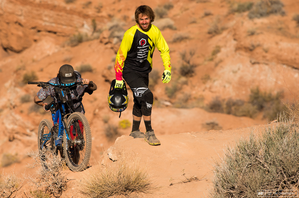 Bike caddies have cool jobs but I bet this one is glad glad he doesn t have to carry a bag full of downhill bikes for every different lip on Kurt Sorge s line.