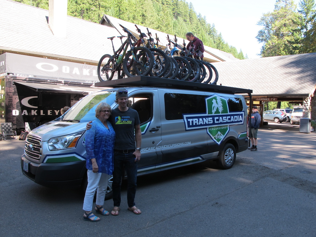 Belknap Lodge owner and Alex of the race pose in front of a loaded up Van before it heads to Oakridge.