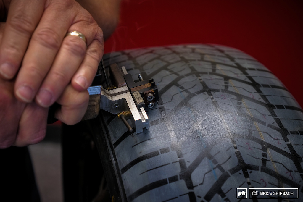 Hand cutting a tread into a passenger car tire gives the ability to test prototypes quickly and without the need for a new mold.