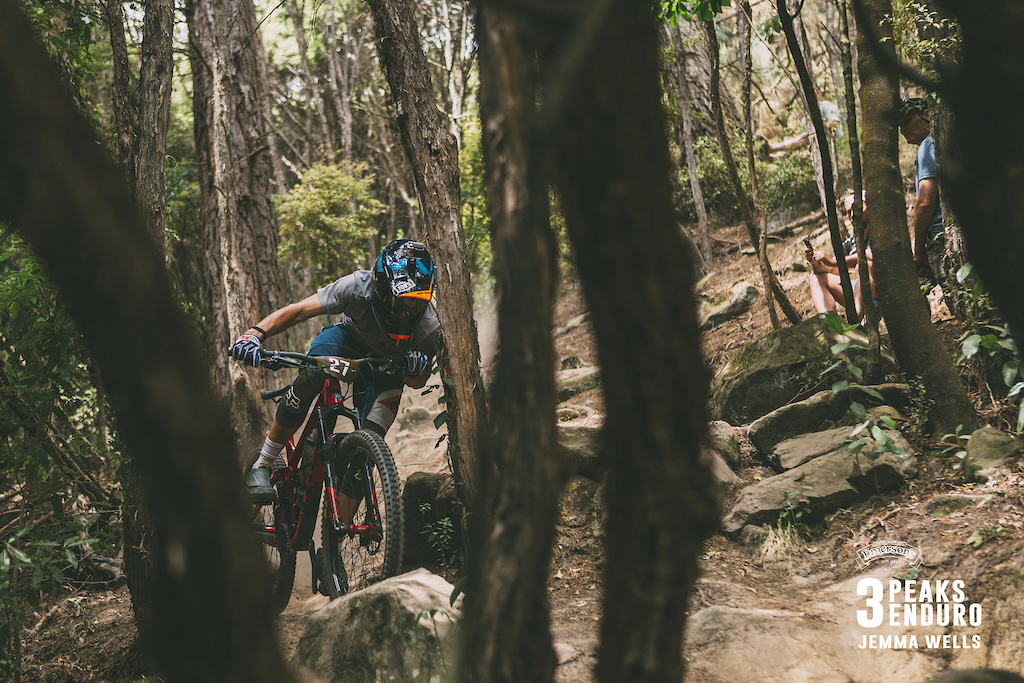 Harlen Hancock of Alexandra cuts all kinds of shapes avoiding the tree on the lower sections of The OC the final stage of the 3 Peaks Enduro.