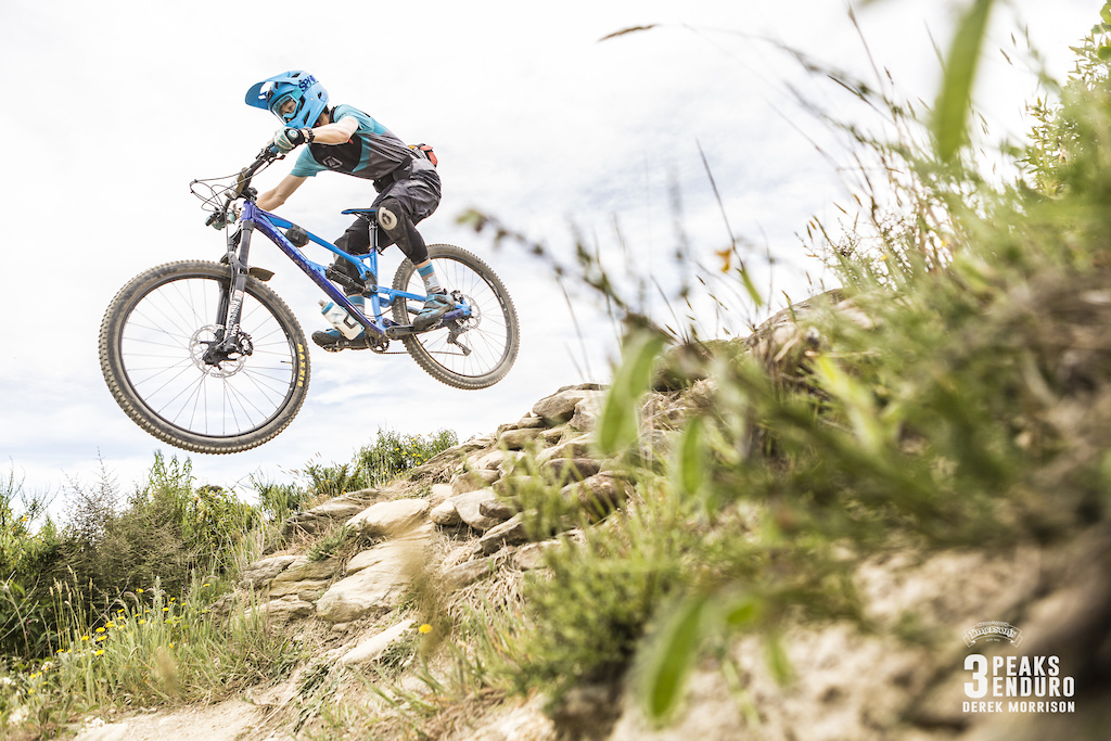 A rider sends it during Day 2 of racing in the sixth edition of the Emerson s 3 Peaks Enduro mountain bike race held in the hills above Dunedin New Zealand at the weekend December 02-03 2017 .