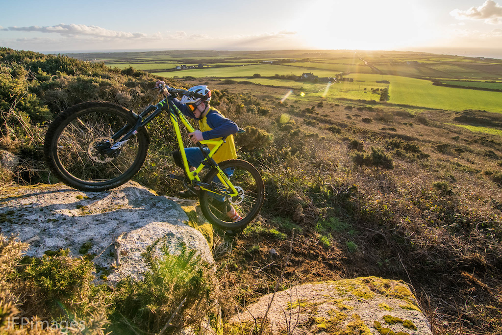 Kieron Hall pushing his Commencal meta up a lump of granite on a Cornish hillside one sunny evening last week during a photoshoot we did.
