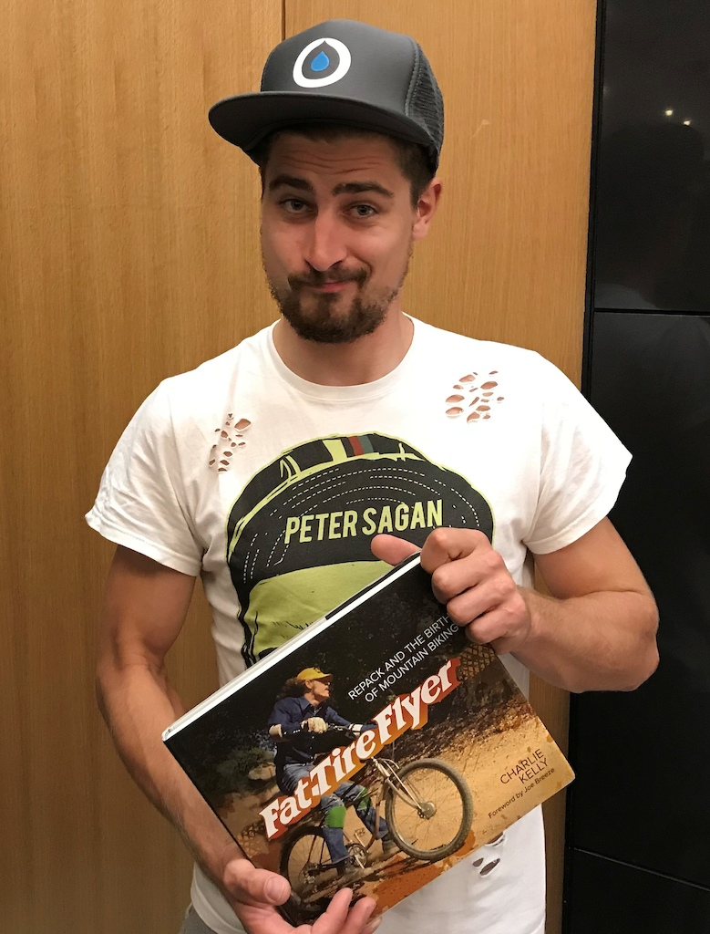 Peteer Sagan holds a copy of my book, Fat Tire Flyer