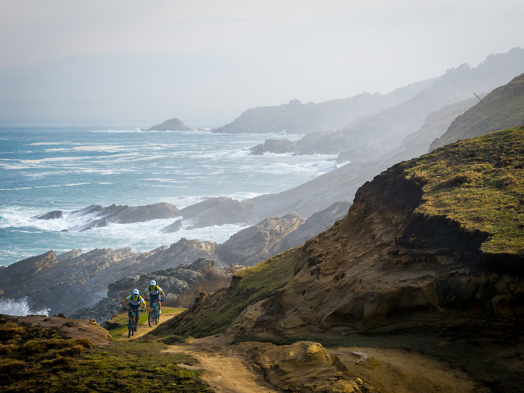Riding on the Basque Coast as the waves pile into the shoreline. 