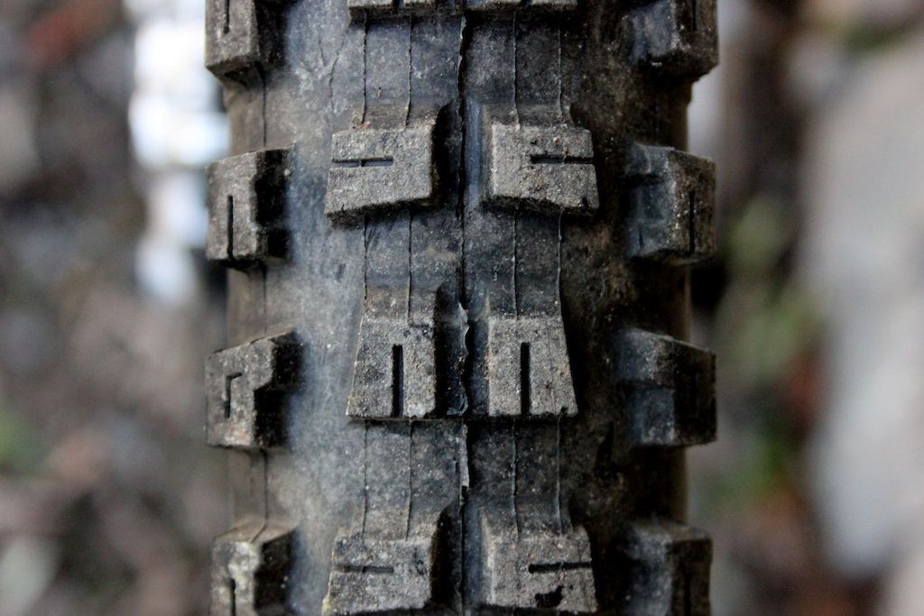 The vertical sipes should help with braking on the narrower and longer tread blocks. The sipe lets the block spread when force is applied to help bite into the terrain