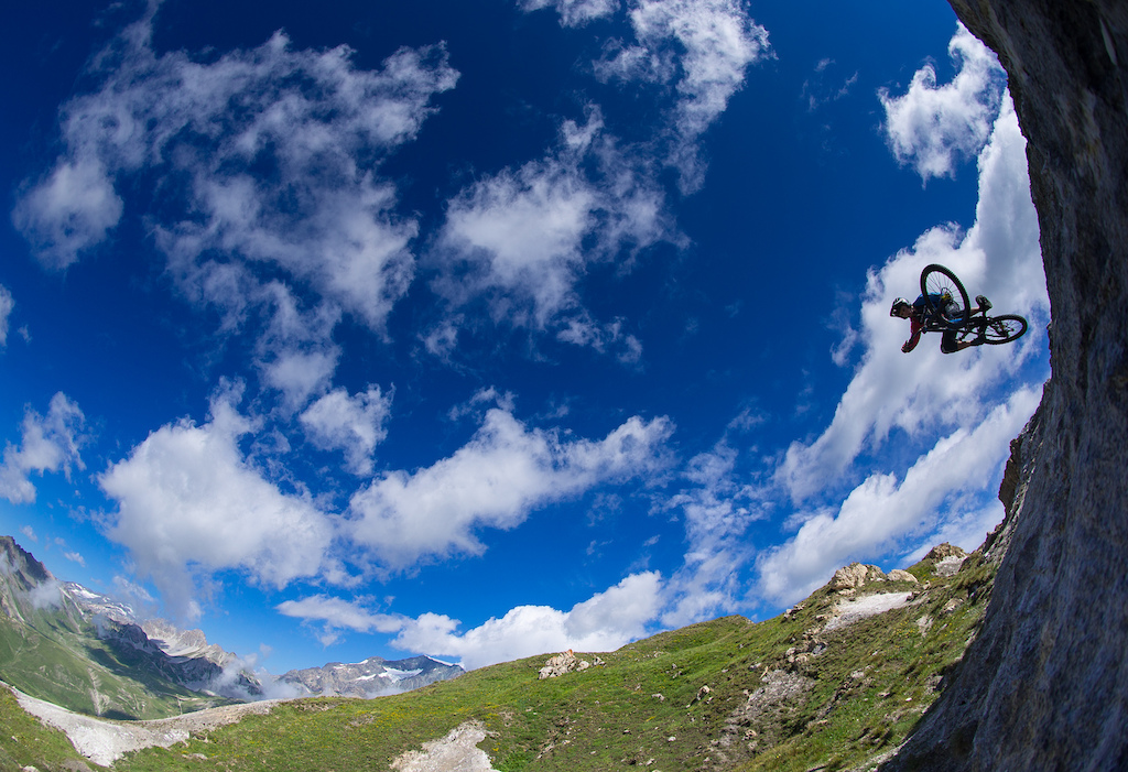 Nathan 'Lizard' McComb laying the table high above Tignes bike park on a scorching July day.