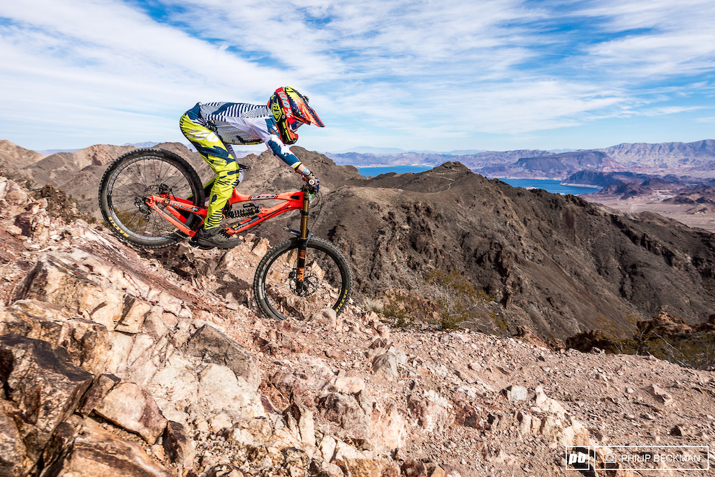 Ryan Pinkerton Rock n Road Cyclery had little time to admire the view of Lake Mead dropping in on his way to the Junior Men 13-14 victory.