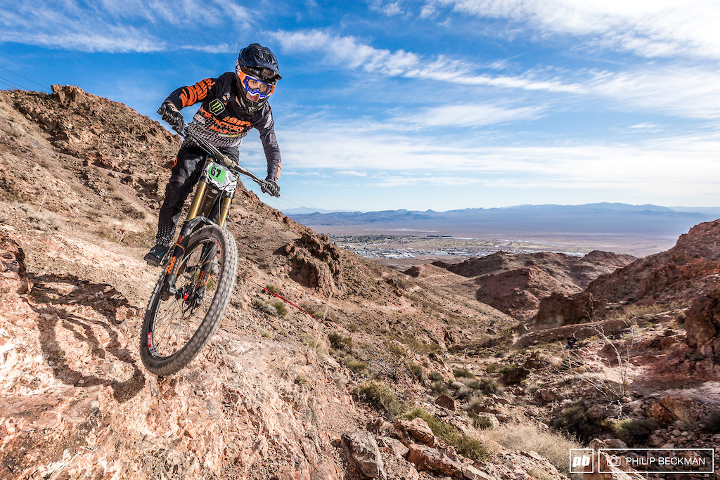 This canyon at the top of Bootleg is always a gut wrencher full of technical traps and steep exposures. Austin Dooley Monster Maxxis Fox 100 navigated the razor sharp rocks and drops handily placing second in Cat 1 Men 15-16.