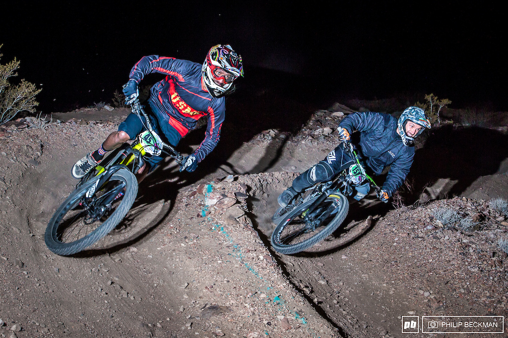 It was a cold dark night for the Dual Slalom competitors and fans and officials and photographers . This is Missoula Montana s Arthur Sykes 45 dicing with Quinn Winter in the Cat 1 Men s 30 class. Sykes would go on to claim the evening s win.