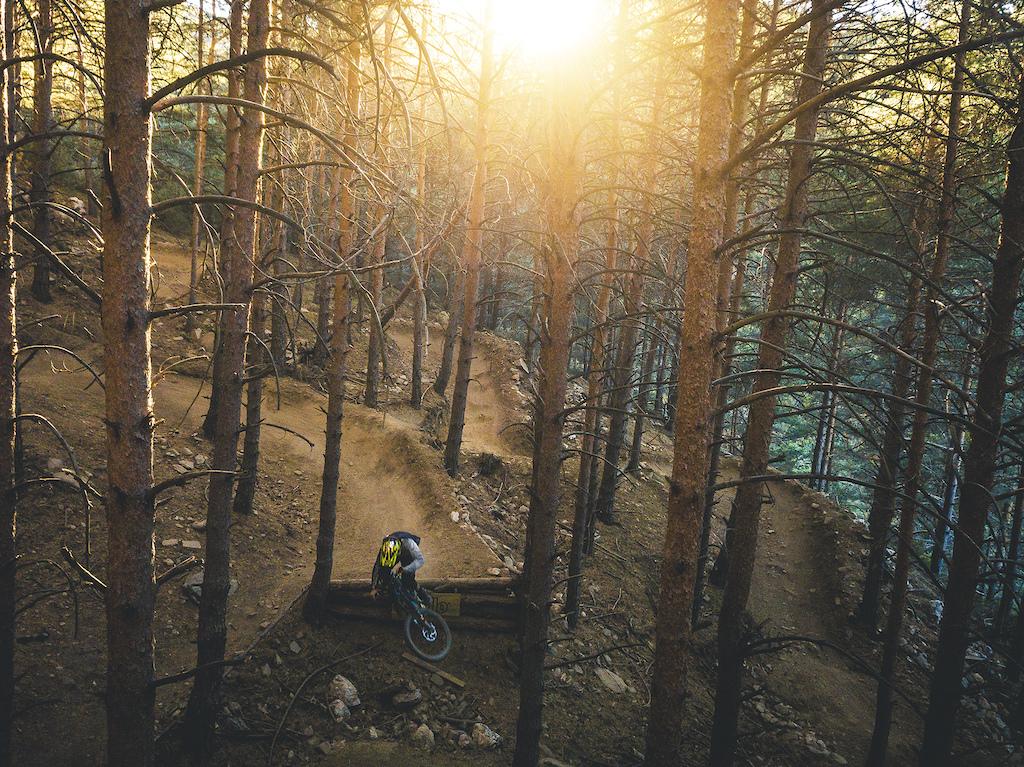 "Lucas Recasens scrubbing the last drop of the ""Bike Patrol"" trail at La Pinilla Bikepark behind the lenses of my DJI Mavic Pro in a sunshine summer afternoon."