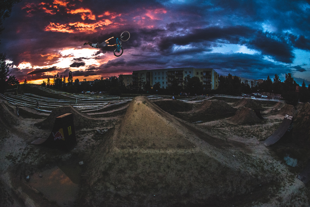 Shot at BikePark Kazoora in Warsaw which I am happy to maintain for the past decade with my best friends. It was after the session for the crowd gathered for the Polish XCO Championship (we couldn't miss a chance to show some straight shaved friends what we can do) when suddenly a massive hailstorm rolled over the city. When the sun finally breakthrough the dark clouds, the colours of the sky melted my mind so I run to put a ladder over a car's roof and shot a quick one with Piotrek Krajewski's signature.