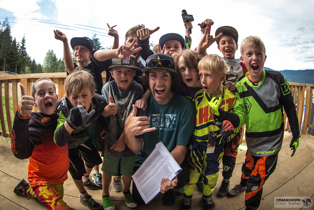 Cam McCaul poses with a group of kids at the Kidsworx B-Line race during Crankworx Whistler in British Columbia Photo by clint trahan crankworx