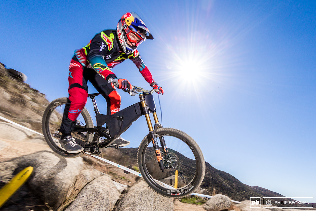 Reigning World Cup Champion Aaron Gwin YT Mob Red Bull turned heads during Saturday s downhill practice taking numerous runs on a cloaked test bike. He did not race on Sunday.
