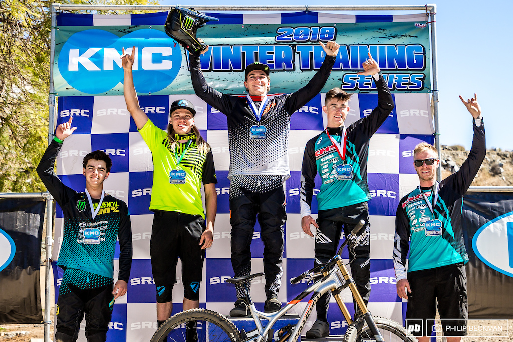 Bruce Klein Commencal 100 stands tall on the Pro Men s DH podium flanked by Nik Nestoroff KHS Factory Racing Cody Kelley Alchemy Steven Walton Commencal and Logan Binggeli KHS Factory Racing .