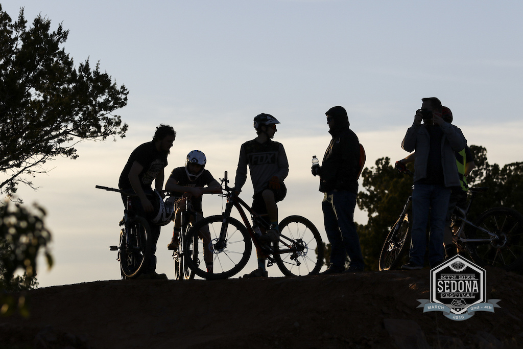 As the day ends on the second day of the festival a handful of riders take in the views and golden light at the bike park.